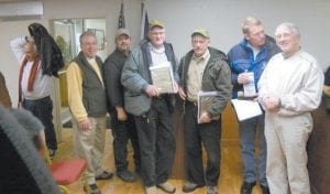 """AT MEETING — Among those attending the December meeting of the Jenkins City Council were, from left, Mayor-Elect G.C. Kincer, Letcher County Development Director Joe De- Priest, Todd DePriest, """"Unsung Heroes"""" Paul Thomas Greer, Ked Sanders and Shad Baker, and Mayor D. Charles Dixon. (Photo by William Farley)"""