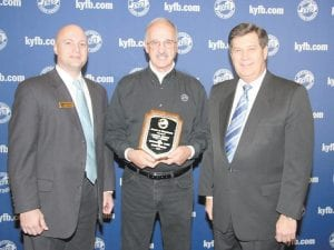 RECOGNIZED — Letcher County Farm Bureau won top honors in the 2010 Safety Challenge Awards competition during Kentucky Farm Bureau's annual meeting in Louisville. The award was given to Letcher County for the safety education it provided to the local community by producing a weekly radio program that focuses on health and safety information. Pictured above, Howard Stanfill (center) received a plaque commemorating Letcher County Farm Bureau's 2010 Safety Challenge award from Dan Smaldone, KFB director of public relations (left), and David S. Beck, KFB executive vice president (right). About 1,300 members attended the 91st annual meeting.