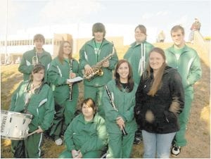 IN THE BAND — Eight members of the Jenkins High School Band attended the 'Marching Colonel for a Day' program at Eastern Kentucky University on Nov. 20. The JHS students performed with the EKU Band during a football game and half-time field show at Roy Kidd Stadium in Richmond. Pictured are (front row, left to right) Brandi Mullins, Samantha Potter, Erica Wright, Band Director Heather Coombs, (back row) William Nickels, Allison Goodson, Michael Kelly, Morgan Henson, and Andrew Adams.