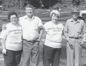 STIDHAM FAMILY — Lucille Stidham Holbrook, Jr. Stidham, and Ruby Stidham Combs are pictured with their father, John Stidham. All are now deceased except Ruby Combs. The photo was made at a Marlowe reunion. The old Marlowe coal tipple is in the background.
