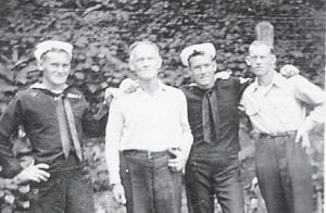 FATHER AND SONS — Pictured are Clyde, Elbert, Maney and Tommy Hatton about 1944. They were Marlowe residents and have all since died.