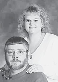 ANNIVERSARY — Frank and Lisa Elkins will celebrate their 13-year wedding anniversary on Dec. 13.