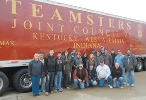 TEN YEARS OF HELPING OTHERS — A group of volunteers from Michigan and Letcher County unloaded Christmas presents, furniture and appliances from two semi-tractor trailers on Sunday. Letcher County native Mary Martin Hendrian and her husband, Jim, cousins Henry and Janet Madden, and others will spend the rest of the week delivering gifts to 12 less fortunate families in Letcher County and two families in Knott County. This marks the 10th year the Hendrians and Maddens have provided gifts to families in Letcher County at Christmastime.