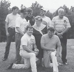 """HOWARD FAMILY — The late Cindy Howard is pictured with her seven sons, Eddie, Hubert, John, Jack, Hillard, Bobby Ray, and Charles. Eddie Howard is now deceased. She had seven daughters also. Whitesburg correspondent Oma Hatton, one of her daughters, says, """"She said she had us to take care of her boys and we helped her spoil them."""""""
