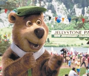"""Yogi Bear (above), voiced by Dan Aykroyd (right) is shown in a scene from """"Yogi Bear."""" (AP Photo/ Warner Bros. Pictures)"""