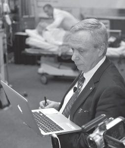 In this March 14, 2010 photo, William Hamman watched data on a computer as he supervised doctors during a cardiology simulation at the Georgia World Congress Center in Atlanta. Hamman, an airline captain who lives in Michigan, claimed to be a cardiologist and trained other doctors in teamwork. But he never got a medical degree. (AP Photo/Gregory Smith)