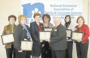 AWARD WINNERS — Eight County Extension agents from the Quicksand Area, including Ann Bradley from Letcher County, recently received an Internet Education Technology Award for a video on canning tomato salsa, sauerkraut, green beans and apple jelly. The video can be viewed by visiting http://www.youtubecom/user/d2kyfcs#p/u. They received the award at the Kentucky Extension Agents of Family and Consumer Sciences (KEFCS) annual meeting in Louisville on Dec. 2. Pictured are (left to right) Glenna Wooten, Perry County; Linda Combs, Knott County; KEFCS President Sally Muneer; Nanette Banks, Leslie County; Ann Bradley, Letcher County; Natasha Lucas, Owsley County; and Martha Yount, Breathitt County. Also in the video are Ann Hollan, Wolfe County, and Crystal Osborne, Lee County.