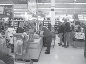 Bob Balthis, secretary of the Lonesome Pine Masonic Lodge 884, signed a check for about $1,400 at the Whitesburg Walmart Dec. 15 to pay for Christmas presents for nine children in Letcher County. The shopping event was paid for by funds raised during the festival season. The Masons also delivered fruit baskets to 10 Masons who aren't able to attend meetings on a regular basis.