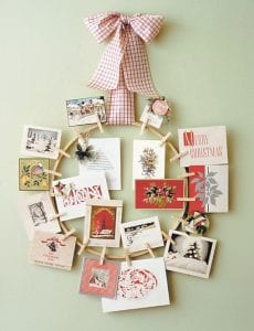 This photo from Martha Stewart Living shows a wreath made from favorite holiday cards. Craft a card wreath with a 14-inch embroidery hoop, mini wooden clothespins, wood glue and holiday cards. Spacing them 1½ inches apart, attach the clothespins to the hoop, alternating those that point out with others that point in, to give the wreath versatility.