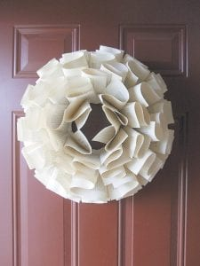 Trisha Muhr says this paper wreath crafted from the pages of old books takes about 35 minutes from start to finish, once you get the hang of it. (AP Photo/Trisha Muhr)