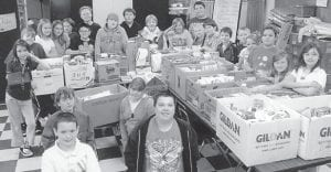 FOOD DRIVE — Students at Letcher Elementary School recently took part in a Thanksgiving food drive. For the event, organized by Brett Lewis and Martha Watts, students collected more than 2,000 food items for distribution to families in the Letcher community for Thanksgiving. The Family Resource Center provided turkey and bread to accompany the 22 baskets of food. The eighth-grade class taught by Manis Blair helped separate the food items into the baskets. Pictured above is the fifth-grade homeroom class of Gina Dotson, which brought in the most items.