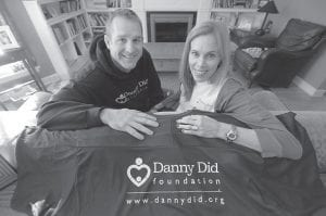 Michael and Mariann Stanton sit in the living room of their home with items that display the logo of the foundation they created to honor their late son Danny. (AP Photo)