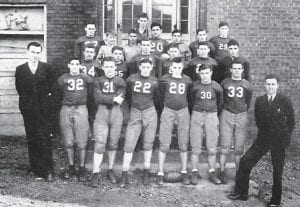 Pictured is the 1938 Fleming football team on which Mr. Enlow was the assistant coach. Front Row: Vincent A. Vaughan (Coach), Sam Alfano (L.E.), Clayton Stapleton (R.T.), Lloyd McMillan (L.H.), James Johnson (C.), Homer Conley (L.G.), Dee Conley (L.T.), Walter Enlow (Asst. Coach), Middle Row: Harry Venters (Q.B.), Ted Pass (Q.B.), Carl Tolliver (R.G.), Lawrence Smith (R.H.), Harold Jenkins (Q.B.), Otis Anderson (L.G.), Back Row: John Bryant (R.E.), Woodrow Reed (L.T.), Rhudell Burklow (Q.B.), Frank Vertuca (F.B.), Harding Dawahare (R.H.), Charles Reynolds (R.G.), Jessie Collier (L.E.), and Raymond Duke (Mgr.).