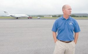 Gary Cox, general manager of Big Sandy Regional Airport, stood on a runway which was once the site of a coal mining operation near Inez, Ky., last August. (AP Photo/James Crisp)
