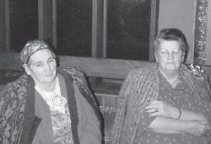"""— The late Cindy and Polly Howard, who were sisters, are pictured during Christmas 1991 at Cowan Community Center. Whitesburg correspondent Oma Hatton says, """"They were two of the best. They married brothers, my dad Bill Howard and Leslie Howard."""""""