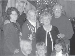 """CHRISTMAS PARTY — Among those attending the Howard Christmas party were Bobby Ray Howard, Jack Howard, Louise Shepherd, Oma Hatton, Kathleen Brock, Charles Howard, Joanne Brown, and Judy Greene. Whitesburg correspondent Oma Hatton says, """"The rest of the gang had wandered off."""""""