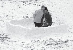 SNOW FUN — Pam Banks and her daughter Haley were busy for two days building a snow fort. They say they hope to add more to the fort with snow forecast for this week.