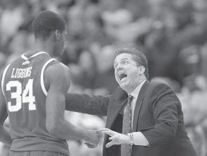 Kentucky head coach John Calipari made a point to guard DeAndre Liggins (34) during the second half of the Georgia game. (AP Photo)