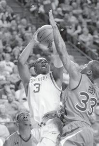 Kentucky's Terrence Jones (3) shot over Auburn's Earnest Ross (33) during the second half of Tuesday's game in Lexington. Jones had 35 points in the 78-54 Kentucky win. (AP Photo/Ed Reinke)