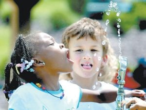 Kindergarten students drink from a fountain in Danville, Pa., in this file photo. Fluoride in drinking water, credited with dramatically cutting cavities and tooth decay, may now be too much of a good thing. (AP Photo)