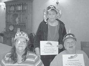 Residents of Letcher Manor Nursing & Rehabilitation donned hats in celebration of Crazy Hat Day. They competed for prizes for the prettiest hat, funniest hat, and most original hat. The winners were (left to right) Judy Webb, funniest; Mabel Banks, prettiest; and Dorothy Joseph, most original.
