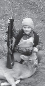 Andy Fields, 7, killed his first deer during the Youth Hunt in January. He is pictured with his doe and his gun. He is the son of Candy and Travis Fields of Red Star, and the brother of Ayden Fields. His grandparents are Sharon and Roger Sexton, Dan and Donna Fields, Debbie and Roger Eldridge, and Donna and Ronald Brown. His great-grandparents are Debbie and Irvin Eldridge, Audrey Sumpter, and Elmo and Deola Day. He is looking forward to killing a buck in October.
