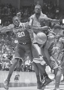 Kentucky guard Doron Lamb (20), Mississippi forward Terrance Henry, center, and Kentucky forward Terrance Jones fought for a rebound in the first half of the game in Oxford, Miss. (AP Photo)