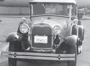 EVERETT VANOVER is pictured in his 1929 Model A rumble seat roadster during a parade and car show at Travis Air Force Base in California, where his car won first place.