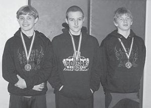 The Letcher County middle school wrestling program competed at the Middle School Wrestling District 8 Tournament held at McCreary County Middle School in Stearns on Jan. 15. Three Letcher County wrestlers received medals in their categories, (left to right) Ethan Riley, Whitesburg Middle School, first place, 140 pounds; Hunter Holbrook, Martha Jane Potter Elementary, second place, 150 pounds; and Clay Caudill, Cowan Elementary, third place, 131 pounds. The three also completed in the Region 4 Tournament at Woodford County Middle School in Versailles on Jan. 22.