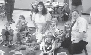 A story hour for preschool children takes place from 11 a.m. to noon on Thursdays at the Harry M. Caudill Library in Whitesburg. The event includes a story, a craft and a snack. Pictured enjoying the story hour are Ian Adams, Kara Stone, Macey Warf, Abby Collins, story lady Jenay Hall, Garrett Howard, Peyton Hammonds, Paxton Hammonds, and volunteer Wendy Vander Molen.