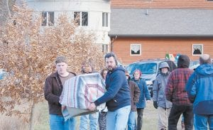 At right, Addison Whitaker (left) and Chris Caudill carried the bald eagle before it was released back into the wild.