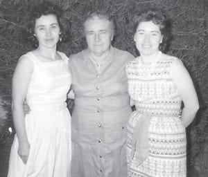The late Mrs. Woodrow Miller poses for a picture with her daughters, Ann (Miller) Vanderpoole and Ada (Miller) King.