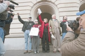 Part of a group calling themselves Kentucky Rising left the state capitol building on Monday to greet the I Love The Mountains Rally in Frankfort. From left to right are Doug Doerrfeld, Patty Wallace, Terri Blanton, Wendell Berry, and Micky McCoy. (AP Photo/The Independent, John Flavell)