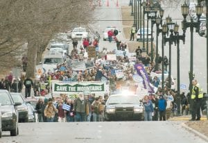 The annual I Love The Mountains Rally marches toward the Kentucky capitol building, Feb. 14, 2011, in Frankfort, Ky. The event, put on by Kentuckians For The Commonwealth, protests the coal mining method of mountaintop removal. (AP Photo/The Independent, John Flavell)