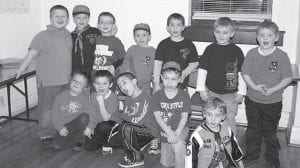 The Tiger Cubs met Feb. 3 and made chocolate chip cookies. Pictured (left to right, top) are Keaston Mark, Sam Collins, Colton Caudill, Trevor Davis, Preston Helle, Andy Fields, Weston Stidham, (bottom) Maddox Adams, Andy Riley, Mercer Quillen, Jonah Fitch, and Cub Scout-in-training Aidan Fields. The Cub Scouts expressed appreciation to Whitesburg Mayor James Wiley Craft, City Clerk Garnet Sexton and the staff of City Hall for allowing the troop to use their facilities.