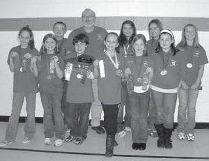 The Cowan Elementary School academic team won district competition at Arlie Boggs Elementary Feb. 26. The team, which placed second overall in quick recall, will now move on to regional competition on March 19. Pictured are (back row, left to right) Alex Fields, fourth in science and fourth in arts and humanities; Coach Gary Sturgill; Makenna Johnson, third in math and fifth in English composition; Nicole Cook; Haley Banks, second in language arts; (front row) Emily Ison, fifth in social studies; Olivia Hammock, fifth in arts and humanities; Garrett Keene, third in social studies; Mackenzie Adams, third in English composition; Hannah Caudill, fifth in science; and Laken Caudill, first in language arts and second in arts and humanities.