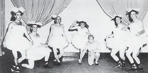 """Coach Moore, always a good sport and willing to participate in all of the school's activities, appeared below in the 1955 production of """"Atomic Darlings"""". Left to Right: Ed Moore, football coach; Sonny Boyd, coach; Ray Pigman baseball coach and director of athletics; Kendall Boggs, """"misleading ballerina"""" and principal of the school; Bill Collins, mathematics instructor; Cecil Caudill, science instructor; and Walter Enlow, social science instructor. Suzanne Adams, head of the Susanne's School of Dance in Whitesburg and Hazard, presented an extravaganza at the Whitesburg High School entitled """"The Atomic Darlings of 1955"""". Many dancers were presented, but the ballet corps shown above took"""