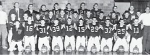 """Coach Moore's Last Team – 1960-61 Yellow Jackets. Front Row L-R: Mgr. Phillip Caudill, #16 Newton Sexton, #31 Talbert Frazier, #39 Ricky Fields, #12 Kenneth Frazier, #15 Eddie Kincer, #29 David Sturgill, #37 Gary """"Round Man"""" Trent, #25 Jack Raleigh, # 11 Kenneth Hall. Middle Row: #24 Wendell """"Buck"""" Sparks, #23 Michael Bentley, #20 Billy Wayne (Roe) Wright, #34 Ronnie Amburgey, #33 Billy Dean Adams, #22 Stevie Stamper, #38 Hiram Wright, #29 Dudley Webb, #10 Gary Pace, #26 Richard York, Brice Baker, Assistant Coach William Henry """"Trim"""" Richardson. Back Row: Head Coach Ed Moore, Assistant Coach Walter """"Pop"""" Enlow, Mgr. Ronda Austin, # 28 Pete Frazier, #14 Roger Day, #36 Fulton Combs, #21 Martin Lewis, #19 Kyle Raleigh, #35 Burkey Fields, Assistant Coach Carroll Sexton. Not pictured are starters Jimmy Stamper, Wilgus Sturgill, Arnold """"Soup"""" Frazier and others Billy Sexton, Danny Wright."""