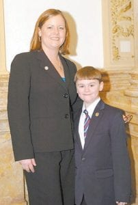 Zachary Hall, 6, was a page for the day on Feb. 17 for Kentucky State Sen. Johnny Ray Turner, D-Drift, who represents Letcher County. Zach is the son of Brandee and Charles Hall of Whitesburg. He is pictured with his aunt, Leslie Caudill, daughter of Barry and Eleanor Caudill of Mayking, who attended Pikeville College and was chosen as an intern her senior year. She was hired the day she was graduated from college, and is director of communications for the Senate Democratic Leadership Office.