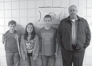 These Whitesburg Middle School sixthgraders have received scholarships to attend Camp Robert C. Webb in Grayson. The scholarships were given on the basis of the students' ability to write letters. Pictured are (left to right) Luke Little, Laila Gernert, Zachari Cokonougher, and Jack Lee of the Kentucky Department of Fish and Wildlife.