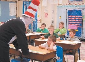 Students in Ms. Harris's 3rd grade class — Ethan Baker, Koby Barnett,Dustin Potter, Kaylee Hash, Sean McCall and Nathanael Champion — watched and listened intently to the Cat in the Hat during his visit to Fleming-Neon Elementary School.