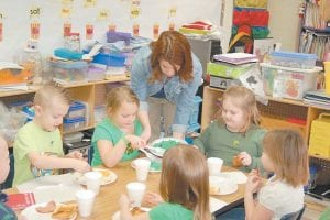 Traci Sexton served green eggs and ham to students Colin Bates, Jaylee Collier, Emily McKinney, Shyla Wilson, and Eden Hayes as part of Fleming-Neon Elementary's celebration of Read Across America week.