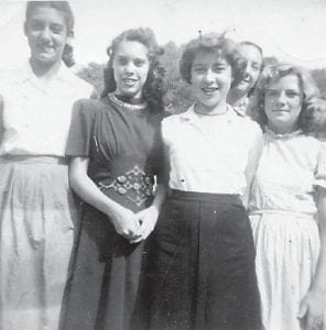 MARLOWE GIRLS — Linda Pennington, Mildred Necessary, Ann Miller, and Betty Sue Howard are pictured when they were all single girls. All except Linda Pennington are grandparents now. James Howard stands in the back.
