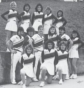 CHEERLEADING SQUAD — Pictured are (front row, left to right) Katrina Nichols, Marti Banks, Sarah Hayes (middle) Lonnie Howard, Shannon Page, Michael Slone, Lena Caudill, Craig Ison, Tracy Combs,(back) Missy Amburgey, Kim Lucas, Kim Brown, Tammy Caudill and Kristi Hatton.