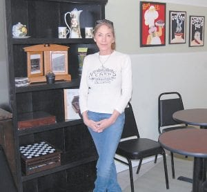 Tina Saylor was photographed recently in The Bakery and Coffee Shoppe in Cumberland, which she owns and operates. The shop is now serving biscuits and gravy to truckers and miners.
