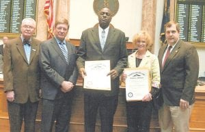 """Letcher County resident Victor Gainer (center) was honored last week by the Kentucky State Legislature on the House and Senate floors for saving the life of Perry County District Judge Leigh Ann Stephens. Judge Stephens was eating lunch at a restaurant in Hazard in summer 2010 when a man stabbed her, prompting Gainer, a Student Engagement Advisor at Hazard Community and Technical College, to jump to her rescue, throwing the man through a window. Shown above, from left, are Bruce Stephens (the judge's father); HCTC President Dr. Steve Greiner, Gainer, Judge Stephens, and State Representative Fitz Steele. Gainer said receiving the honor made him feel like he was """"on a cloud."""" """"It was unreal because of where I came from. I feel like I have really done something with my life,"""" Gainer said. Gainer works to keep students enrolled in school and makes public appearances about the value of a good education."""