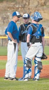 Letcher Central High School head baseball coach Bryan Dean made a trip to the mound Monday to talk with pitcher Jordan Short, center, and catcher Ethan Mason during the Cougars' 13-5 win over Pound on opening day. (Photo by Chris Anderson)