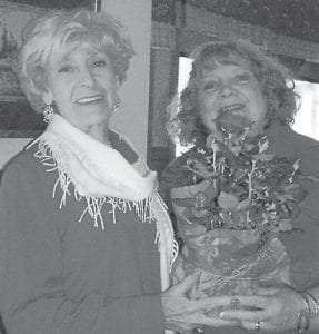 Sally Caudill is the spring sweetheart of the Daughters of the American Revolution (DAR). She was chose because of her length of membership and her support and service to the Pine Mountain Chapter of the DAR. Presenting her with roses is her niece, Ann Reynolds.