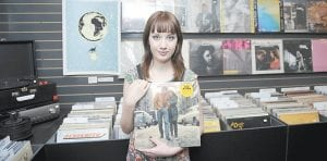 "Sarah McCarthy, 16, of Centreville, Md., holds the Bob Dylan album, ""The Freewheelin',"" at KA-CHUNK!! Records in Annapolis, Md. (AP Photo)"