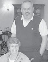 — A St. Patrick's Day party was held March 17 at Letcher Manor Nursing & Rehabilitation Facility in Whitesburg. After enjoying food and music, the residents gathered in the activity room to cheer on the University of Kentucky Wildcat basketball team. Pictured are Betty Wood and her grandson Jeffery Proulex, director of admissions at Letcher Manor.